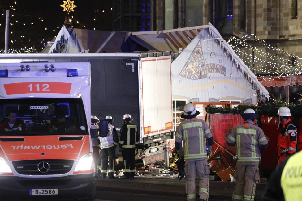 Firefighter stand beside a truck at a Christmas market in Berlin
