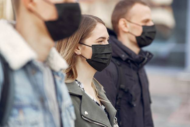 people-masks-stands-street_1157-31567